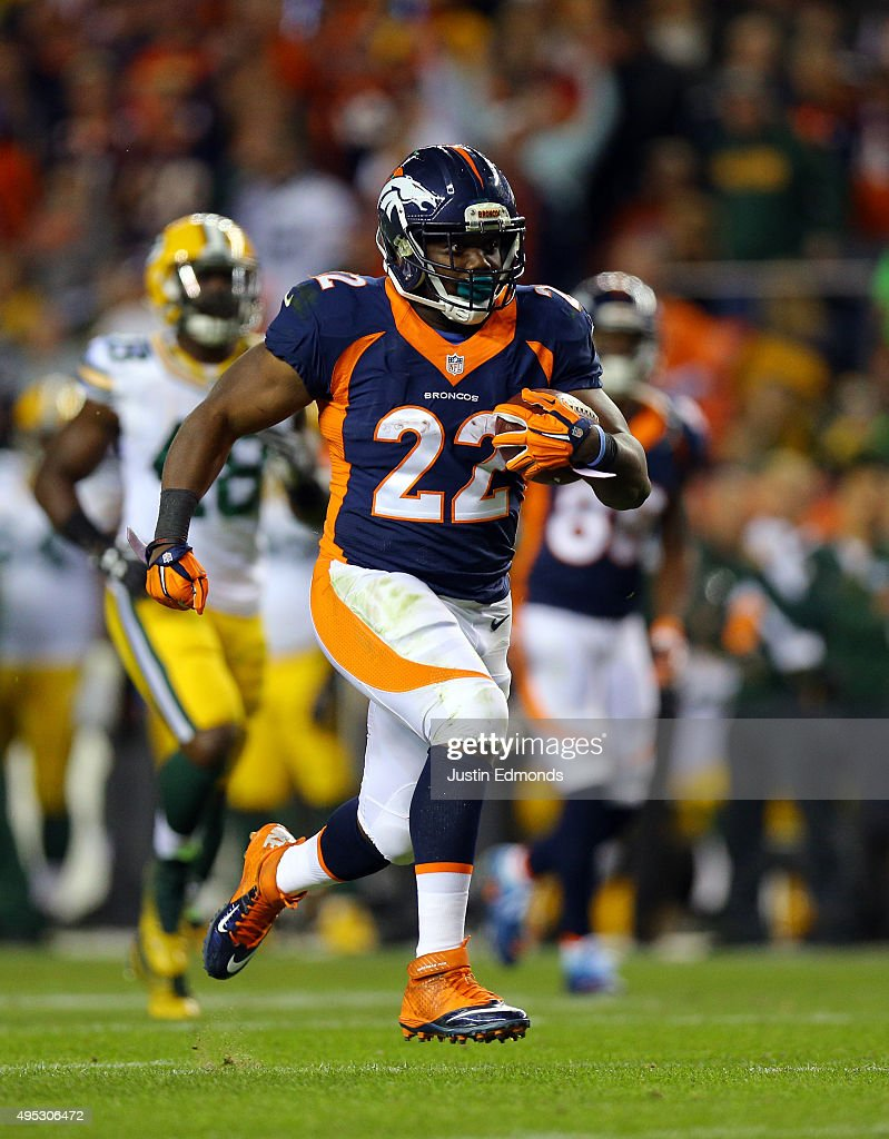 C.J. Anderson #22 of the Denver Broncos runs the ball for a third quarter touchdown against the Green Bay Packers at Sports Authority Field at Mile High on November 1, 2015 in Denver, Colorado.