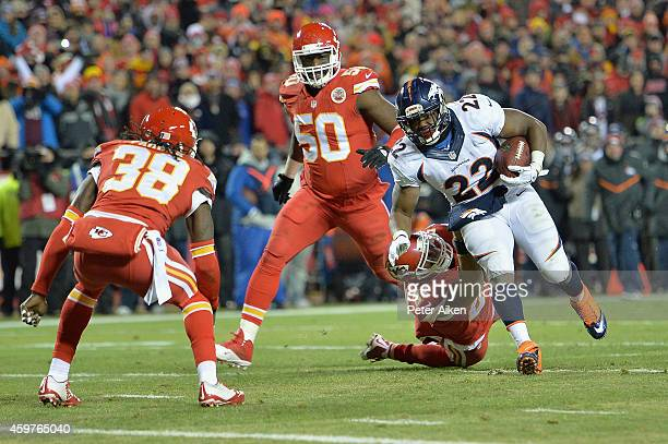Anderson of the Denver Broncos runs the ball for a touchdown against Kurt Coleman, Ron Parker, and Justin Houston of the Kansas City Chiefs during...