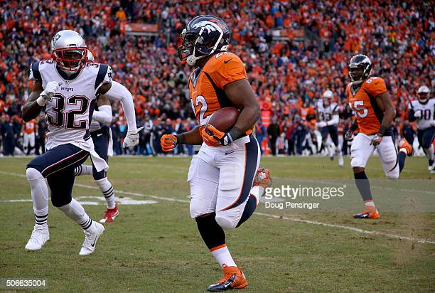 J Anderson of the Denver Broncos runs with the ball against Devin McCourty of the New England Patriots in the second half in the AFC Championship...