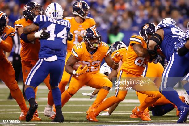 J Anderson of the Denver Broncos runs with the ball against the Indianapolis Colts during the second half at Lucas Oil Stadium on December 14 2017 in...