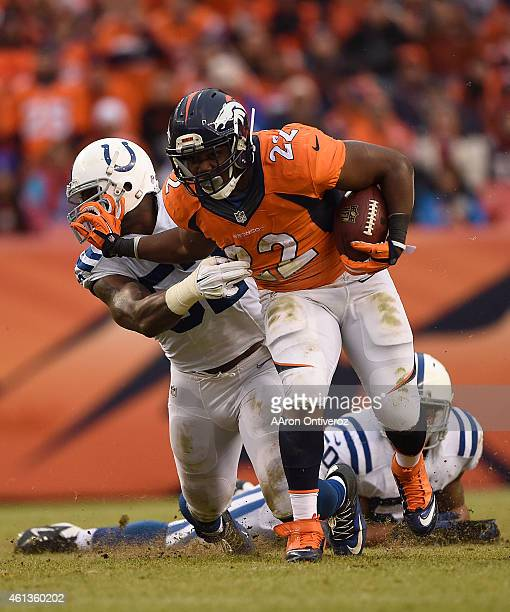 J Anderson of the Denver Broncos stiffarms Colt Anderson of the Indianapolis Colts on a run in the second quarter The Denver Broncos played the...