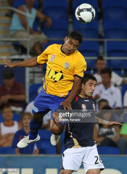 Anderson of the Gold Coast gets above Ali Abbas of the Jets as they challenge for the ball during the round 19 A-League match between Gold Coast...