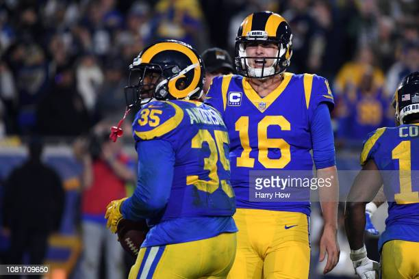 J Anderson of the Los Angeles Rams celebrates wil Jared Goff after a 1 yard touchdown run in the fourth quarter against the Dallas Cowboys in the NFC...