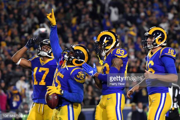 J Anderson of the Los Angeles Rams celebrates with teammates after scoring a 1 yard touchdown in the second quarter against the Dallas Cowboys in the...