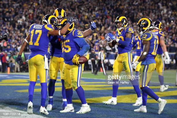 J Anderson of the Los Angeles Rams celebrates with teammates after a 1 yard touchdown run in the fourth quarter against the Dallas Cowboys in the NFC...