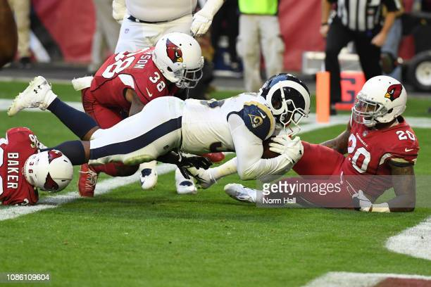 J Anderson of the Los Angeles Rams rushes in a four yard touchdown against the Arizona Cardinals in the first half of the NFL game at State Farm...