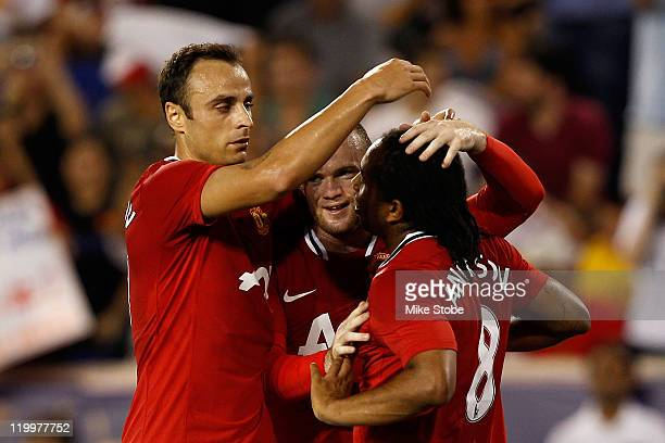 Anderson of the Manchester United celebrates scoring a goal in the twentieth minute with teammates while playing against the MLS All-Stars during the...