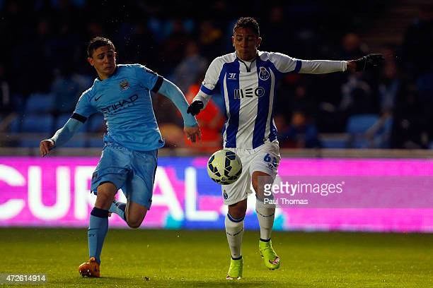 Anderson Oliveira of FC Porto in action with Pablo Maffeo of Manchester City during the Premier League International Cup Final match between...