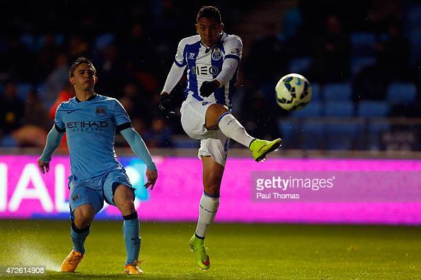 Anderson Oliveira of FC Porto shoots at goal past Pablo Maffeo of Manchester City during the Premier League International Cup Final match between...