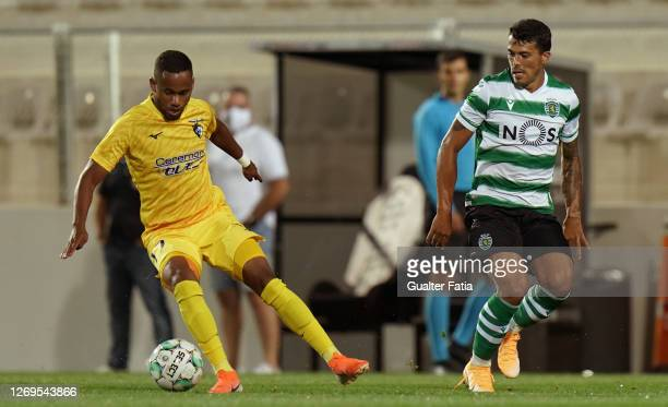 Anderson Oliveira of Portimonense SC with Pedro Porro of Sporting CP in action during the Friendly match between Portimonense SC and Sporting CP at...