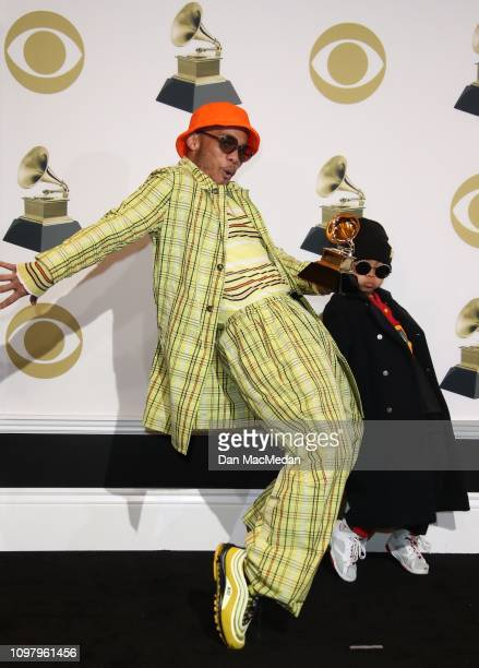 Anderson Paak and his son Soul Rasheed pose in the press room with his award for Best Rap Performance award for 'Bubblin' during the 61st Annual...