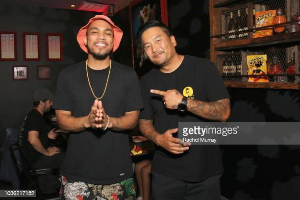 Anderson Paak and Roy Choi attend The Flamin Hot Spot Cheetos new limitedtime restaurant with a menu inspired by chef Roy Choi at Madera Kitchen on...