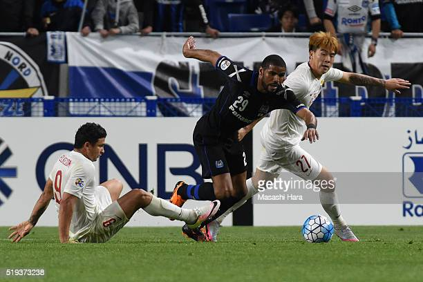 Anderson Patric Aguiar Oliveira of Gamba Osaka and Shi Ke Elkeson De Oliveira Cardoso of Shanghai SIPG compete for the ball during the AFC Champions...