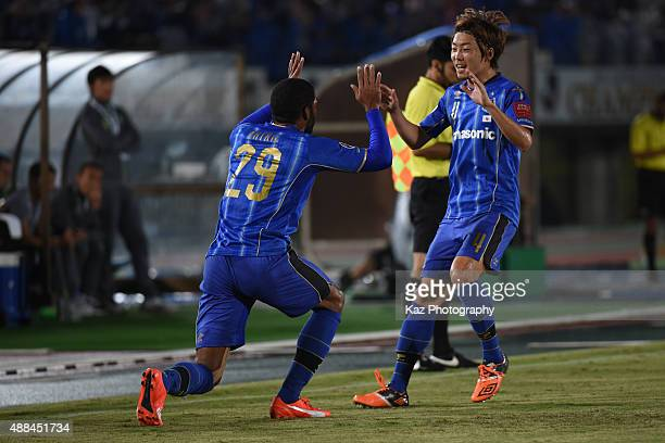 Anderson Patric Aguiar Oliveira of Gamba Osaka celebrates his equaliser with Hiroki Fujiharu of Gamba Osaka during the AFC Champions League quarter...