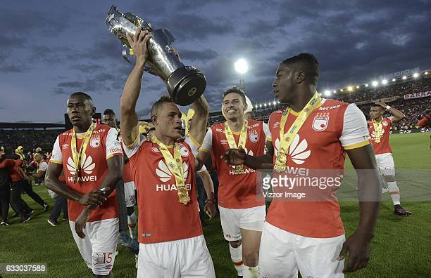 Anderson Plata Hector Urrego Jose Adolfo Valencia of Santa Fe celebrate with the trophy of Superliga Aguila 2017 after winning a second leg final...