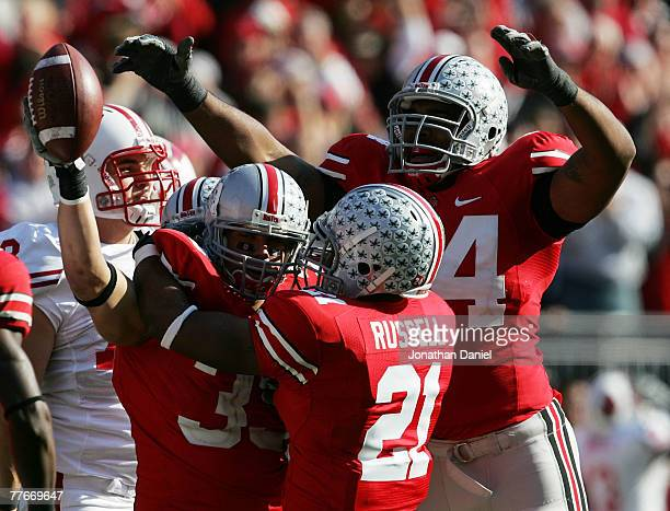 Anderson Russell and Doug Worthington of the Ohio State Buckeyes celebrates with teammate James Laurinaitis after Laurinaitris recovered a fumble by...