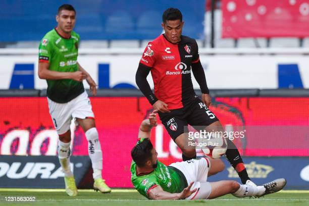 Anderson Santamaría of Atlas fights for the ball with Elio Castro of FC Juarez during the 10th round match between Atlas and Juarez as part of the...