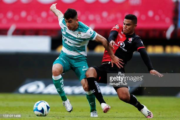 Anderson Santamaría of Atlas fights for the ball with Jesús Ocejo of Santos during the 5th round match between Atlas and Santos Laguna as part of...