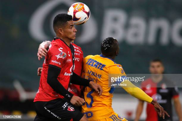 Anderson Santamaría of Atlas fights for the ball with Julián Quiñones of Tigres during the 3rd round match between Atlas and Tigres UANL as part of...