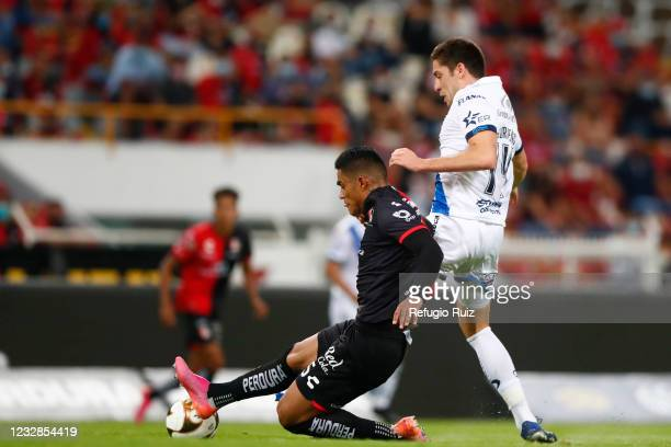 Anderson Santamaría of Atlas fights for the ball with Santiago Ormeño of Puebla during the quarterfinals first leg match between Atlas and Puebla as...