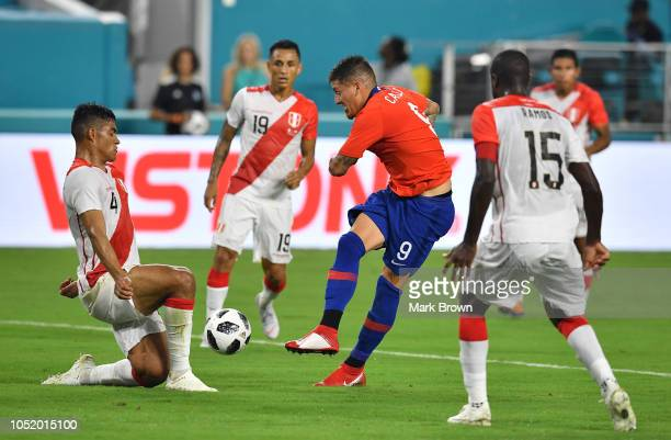 Anderson Santamaría of Peru blocks a kick by Nicolas Castillo of Chile during the International Friendly 'Clasico del Pacifico at Hard Rock Stadium...