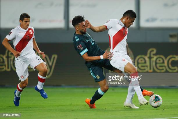 Anderson Santamaría of Peru fights for the ball with Nicolás González of Argentina during a match between Peru and Argentina as part of South...