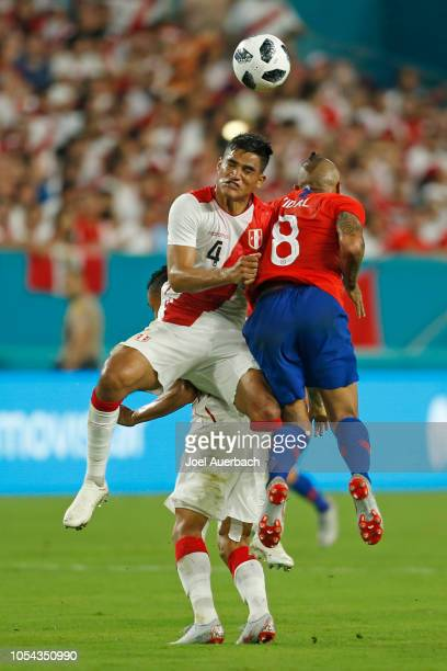 Anderson Santamaría of Peru goes up for the ball against Arturo Vidal of Chile during an International friendly match on October 12 2018 at Hard Rock...