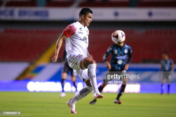 Anderson Santamaria of Atlas controls the ball during the 2nd round match between Queretaro and Atlas as part of the Torneo Guard1anes 2021 Liga MX...