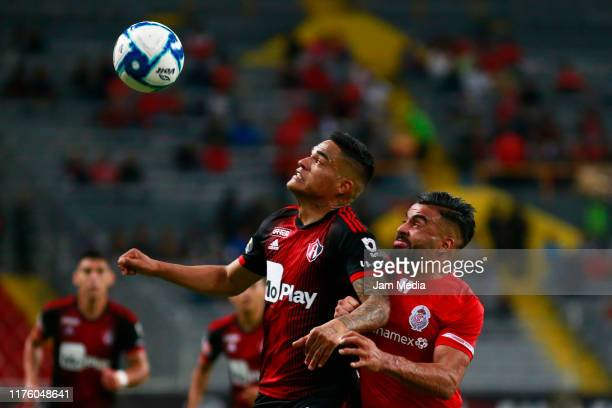 Anderson Santamaria of Atlas fights for the ball with Alexis Canelo of Toluca during the 10th round match between Atlas and Toluca as part of the...