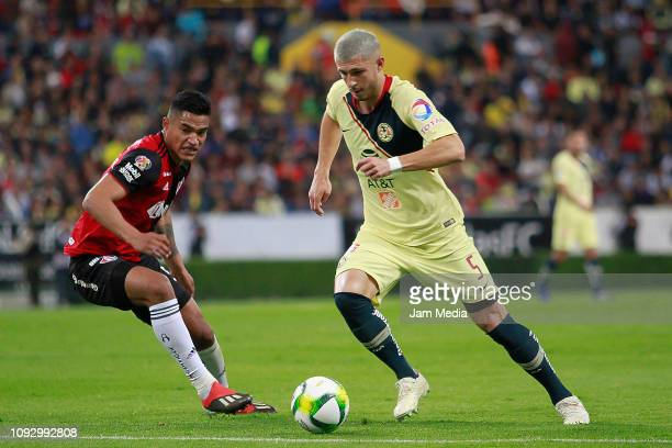 Anderson Santamaria of Atlas fights for the ball with Guido Rodriguez of America during the 2nd round match between Atlas and America as part of the...