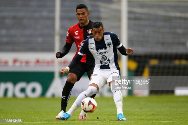 Anderson Santamaria of Atlas fights for the ball with Rogelio Funes Mori of Monterrey during the 1st round match between Atlas and Monterrey as part...