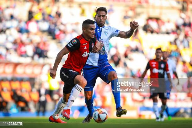 Anderson Santamaria of Atlas struggles for the ball against Jose Ulloa of Pachuca during the 16th round match between Pachuca and Atlas as part of...