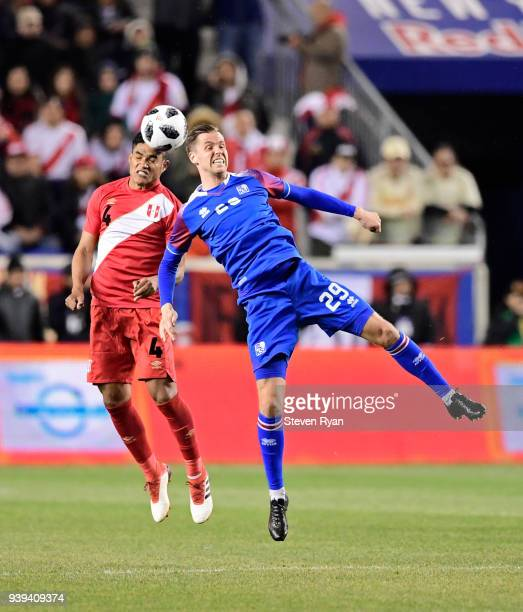 Anderson Santamaria of Peru and Kjartan Finnbogason of Iceland battle for the header in an International Friendly match at Red Bull Arena on March 27...