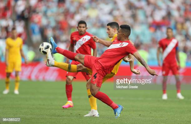 Anderson Santamaria of Peru controls the ball ahead of Tom Rogic of Australia during the 2018 FIFA World Cup Russia group C match between Australia...