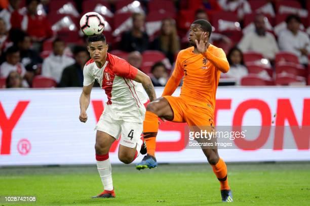 Anderson Santamaria of Peru Georginio Wijnaldum of Holland during the International Friendly match between Holland v Peru at the Johan Cruijff Arena...