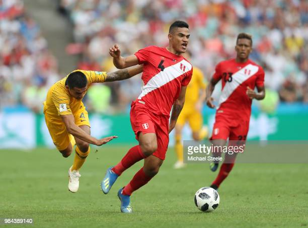 Anderson Santamaria of Peru is challenged by Tim Cahill of Australia during the 2018 FIFA World Cup Russia group C match between Australia and Peru...