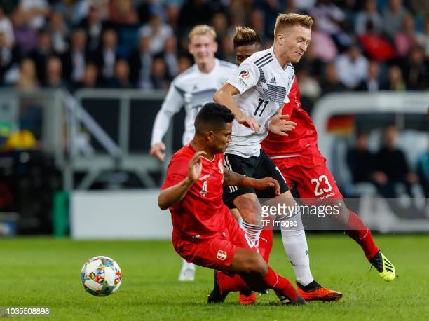 Anderson Santamaria of Peru Pedro Aquino of Peru and Marco Reus of Germany battle for the ball during the International Friendly match between...