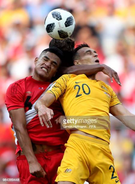 Anderson Santamaria of Peru Pedro Aquino of Peru and Trent Sainsbury of Australia compete for a header during the 2018 FIFA World Cup Russia group C...
