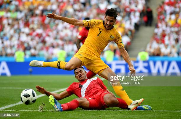 Anderson Santamaria of Peru slides in to tackle Mathew Leckie of Australia during the 2018 FIFA World Cup Russia group C match between Australia and...