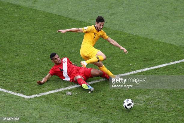 Anderson Santamaria of Peru tackles Mathew Leckie of Australia during the 2018 FIFA World Cup Russia group C match between Australia and Peru at...