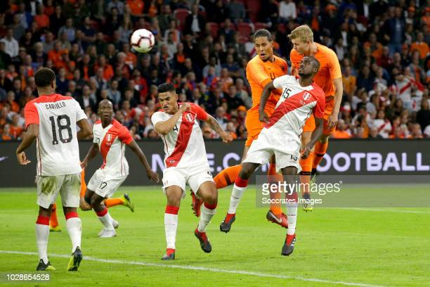 Anderson Santamaria of Peru Virgil van Dijk of Holland Matthijs de Ligt of Holland Christian Ramos of Peru during the International Friendly match...