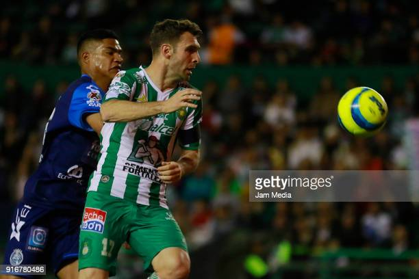 Anderson Santamaria of Puebla and Mauro Boselli of Leon fight for the ball during the 6th round match between Leon and Puebla as part of the Torneo...