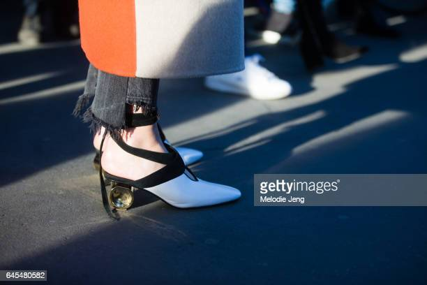 W Anderson shoes outside Jil Sander during Milan Fashion Week Fall/Winter 2017/18 on February 25 2017 in Milan Italy