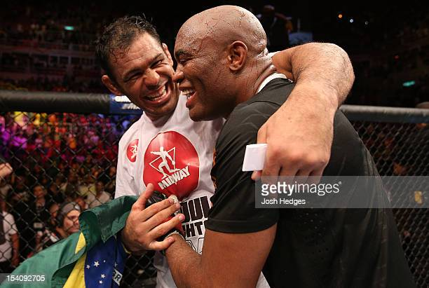 Anderson Silva and his teammate Antonio Rodrigo Minotauro Nogeuira celebrate after Silva's victory over Stephan Bonnar during their light heavyweight...