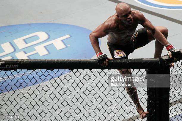 Anderson Silva celebrates after defeating Yushin Okami in a lightweight bout at UFC 134 at HSBC Arena on August 27 2011 in Rio de Janeiro Brazil