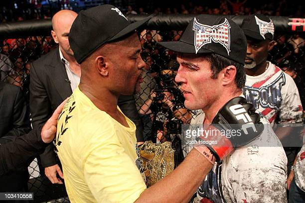 Anderson Silva hugs Chael Sonnen following the UFC Middleweight Championship bout at Oracle Arena on August 7 2010 in Oakland California