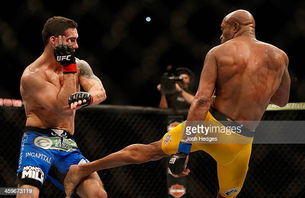 Anderson Silva kicks Chris Weidman in their UFC middleweight championship bout during the UFC 168 event at the MGM Grand Garden Arena on December 28...