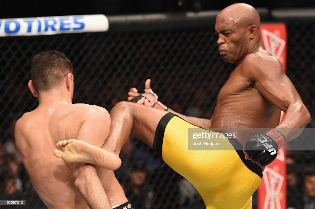 Anderson Silva kicks Nick Diaz in their middleweight bout during the UFC 183 event at the MGM Grand Garden Arena on January 31, 2015 in Las Vegas, Nevada.