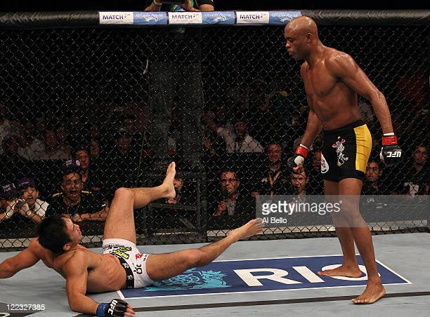 Anderson Silva moves in for the finish against Yushin Okami after knocking him down in the UFC Middleweight Championship bout at UFC 134 at HSBC...
