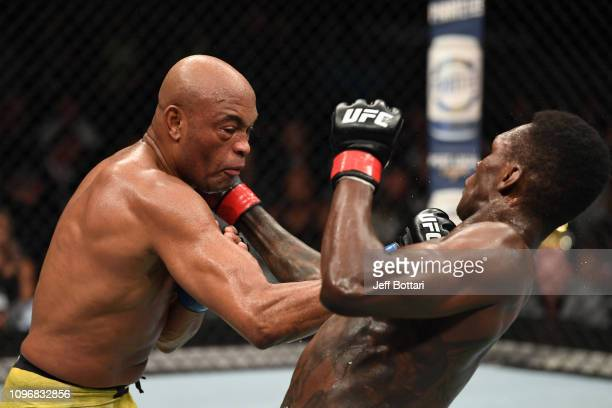 Anderson Silva of Brazil and Israel Adesanya of New Zealand exchange punches in their middleweight bout during the UFC 234 at Rod Laver Arena on...